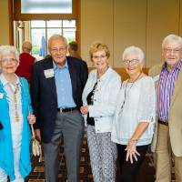 Friends posing together at the Retiree Reception.